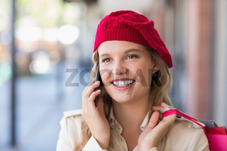 A happy smiling woman calling