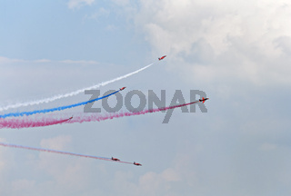 Planes on an air show against cloudy sky