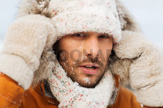 face of man in winter clothes outdoors