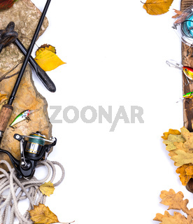 fishing tackles on stones with anchor and leafs