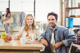 Portrait of smiling man and woman during coffee break
