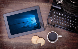 HEERENVEEN, NETHERLANDS, June 6, 2015: Tablet computer with Windows 10 background. Windows 10 is the new version of Windows OS by Microsoft Corporation; it starting July 29, 2015.