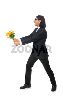 Handsome businessman with flower isolated on white