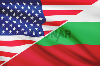 Flags of USA and Bulgaria blowing in the wind. Part of a series.