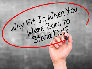 Man Hand writing Why Fit In When You Were Born to Stand Out? with black marker on visual screen.