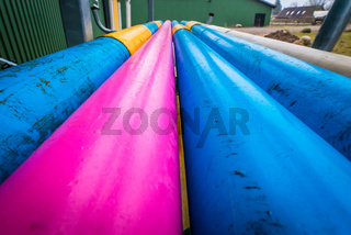 Colorful pipes at a farm