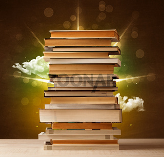 Magical books with ray of magical lights and colorful clouds