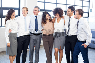 Businesspeople standing together in office