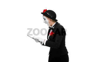 business woman in the image mime holding tablet PC