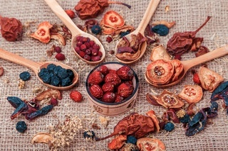 Dried fruit and berries on sacking background