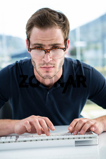 Handsome man using computer
