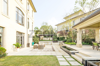 empty footpath through yard to modern building