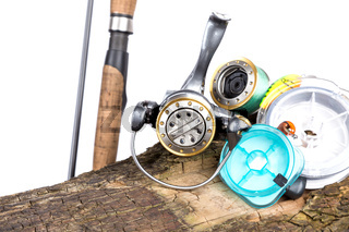 fishing tackles and fishing baits on wooden