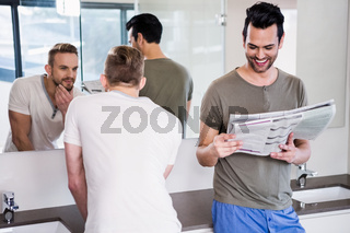 Smiling gay couple in the bathroom