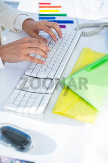 Businesswoman using her pc with documents