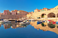 Dubrovnik harbor and city walls morning panoramic view