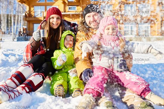 Parents and kids enjoying winter