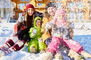 Parents and kids enjoying winter