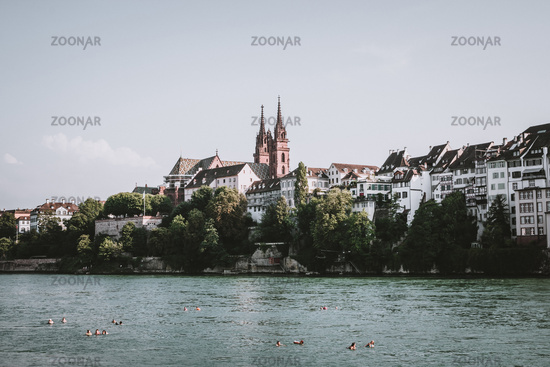 View on Basel city and river Rhine, Switzerland. People swim in water