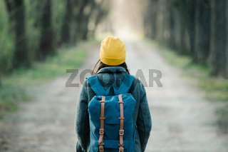 Young woman walking on an avenue on her travel journey.