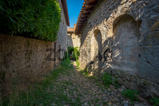 Narrow alley paved with pebble stones, Perouges, France