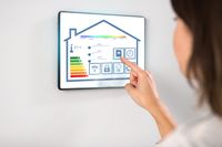woman using tablet computer at smart home
