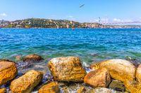 Bosphorus coast stones, the Sultan Fatih Mehmet Bridge and the Rumeli Hisari in the background