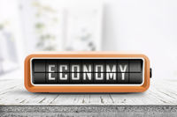 Economy word on an analog device in a bright home