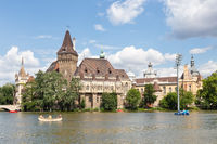 Budapest Vajdahunyad Castle with people with blurred faces in boats