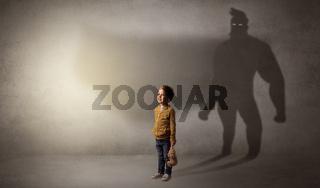 Cute kid with hero shadow behind