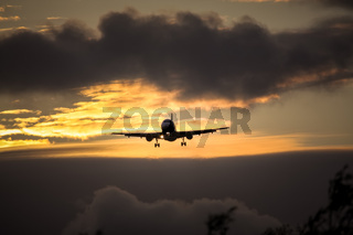 air plane in sunset sky