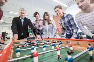 Employees playing table soccer