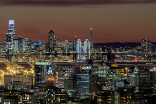 Oakland and San Francisco Twilight Skylines Illuminated with Holiday Lights.