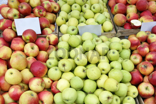 Street market of fresh  red and green garden apples fruits  in wooden boxes