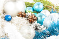 Christmas and New Year composition with fir tree branch, beautiful silver ball and silver cones