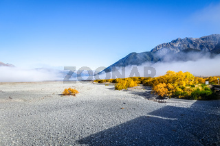 Fog on plain in New Zealand mountains