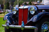 A classic antique black car, red Grille