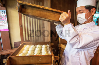 the chef and owner of a small cafe demonstrates sweet buns. MARCH 22