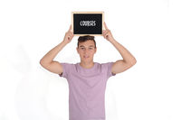 Man holding a chalkboard with