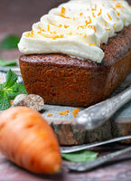 Spicy carrot cake with cottage cheese cream. close up.