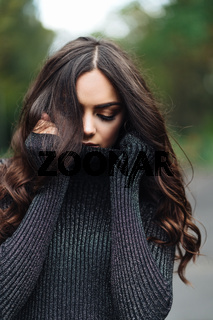 Outdoor portrait of young pretty beautiful calm woman