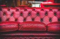 empty red sofa in cosy lounge room old-fashioned vintage closeup