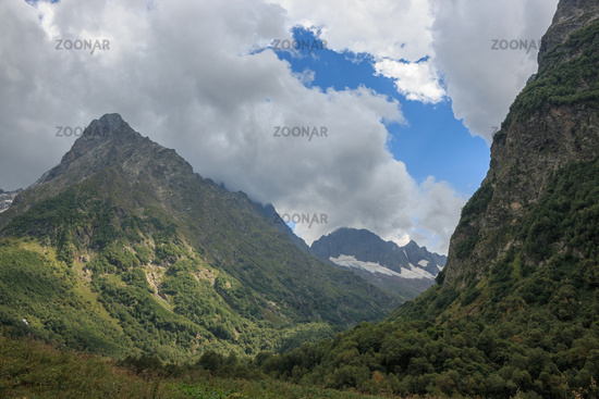 Panorama view on mountains scene in national park of Dombay, Caucasus