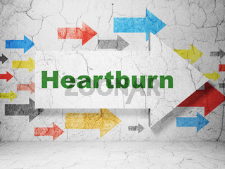 Health concept: arrow with Heartburn on grunge wall background