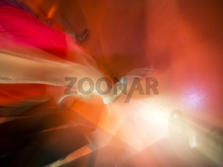 Woman with red dress dancing in discotheque