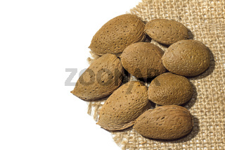 Isolated Almonds on the linen fabric