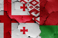 flags of Georgia and Belarus painted on cracked wall