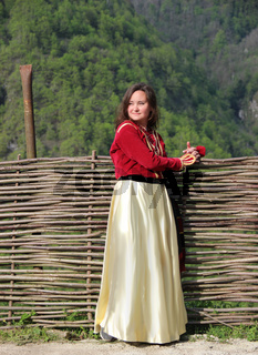 Photo of young brunette woman in a traditional georgian costume