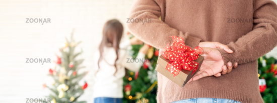 Man hold christmas gift surprise