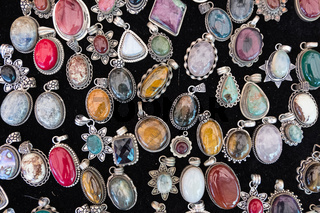 Stone vintage pendants display.